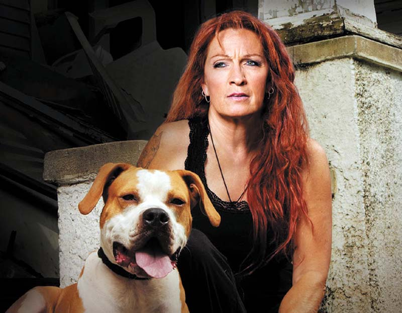 Photo of Tia Torres with her pitbull.