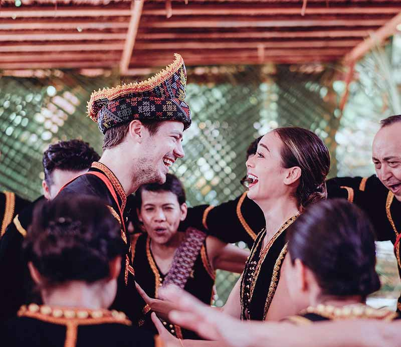Wedding photo of Andrea Thoma and husband, Grant Gustin in Malaysian.