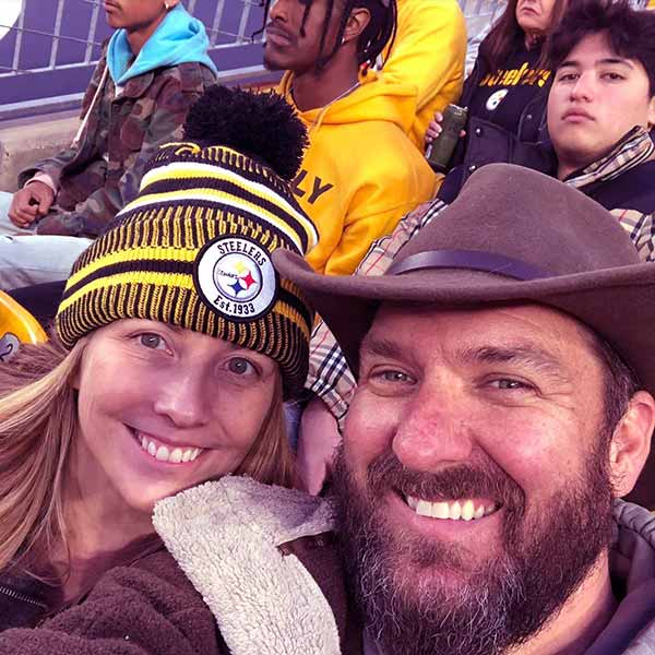 Image of an American tv personality, Mark Bowe and his wife